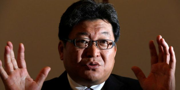 Japan's Deputy Chief Cabinet Secretary Koichi Hagiuda speaks during an interview with Reuters at Prime...