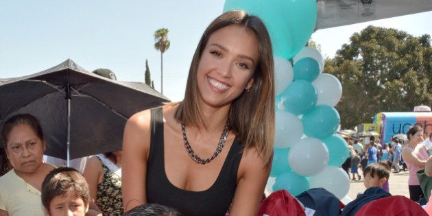 ARLETA, CA - AUGUST 17: The Honest Company's Jessica Alba hands out Honest + STATE Bags with Yoobi supplies...