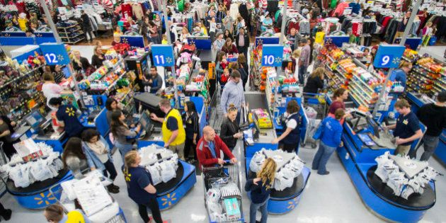 IMAGE DISTRIBUTED FOR WALMART - Customers leave happy from a Walmart store in Bentonville, AR, with their...