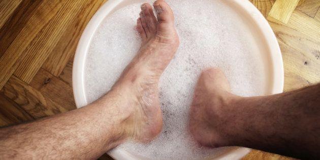 Man soaking his feet in a