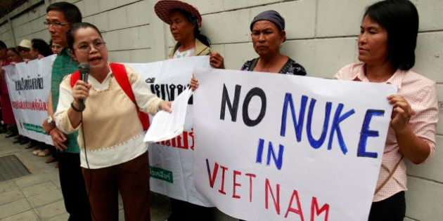 Anti-nuclear activists hold placards during a protest outside the Vietnamese embassy in Bangkok April...