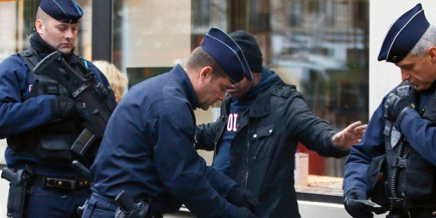 A troublemaker is arrested by French Police officers in front of the Bataclan concert hall in Paris,...