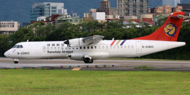 Taipei, Taiwan - May 18, 2014: A TransAsia Airways ATR 72-500 with the registration B-22803 taxis at...