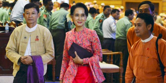 Myanmar opposition leader Aung San Suu Kyi, center, walks along with other lawmakers of her National...