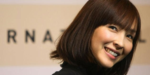 Japanese actress Kumiko Aso poses during the 'Hafez' photocall at the second annual film festival, 19...
