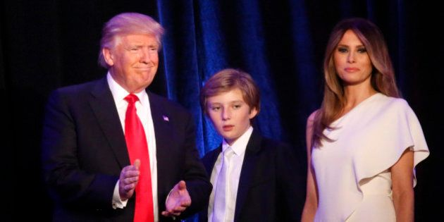 Republican U.S. president-elect Donald Trump stands with his son Barron (C) and wife Melania at his election...