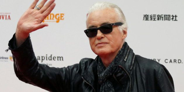 British rock musician and former guitarist for Led Zeppelin, Jimmy Page poses on the red carpet at the...