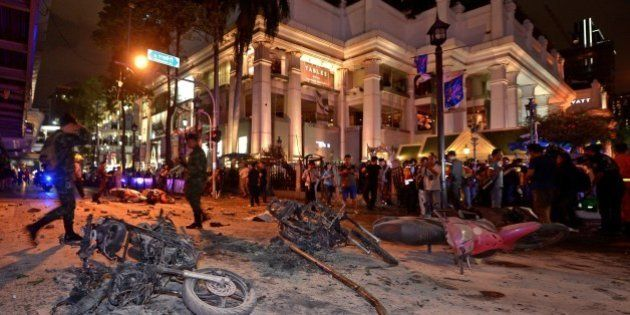 Thai soldiers inspect the scene after a bomb exploded outside a religious shrine in central Bangkok late...