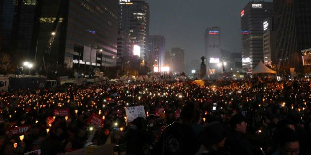 South Korean protesters hold up candles during a rally calling for South Korean President Park Geun-hye...