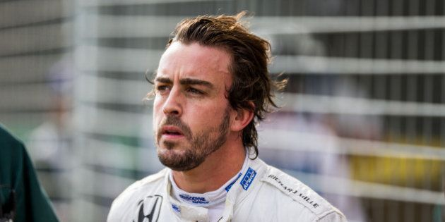 MELBOURNE, AUSTRALIA - MARCH 20: Fernando Alonso of McLaren and Spain immediately after his crash during...