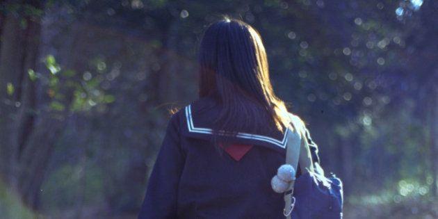 School girl walking up the