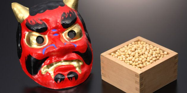 Japanese 'Oni' devil mask with box of 'edamame'