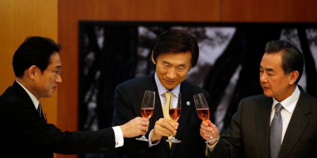 From left, Japanese Foreign Minister Fumio Kishida, South Korean Foreign Minister Yun Byung-se and Chinese...
