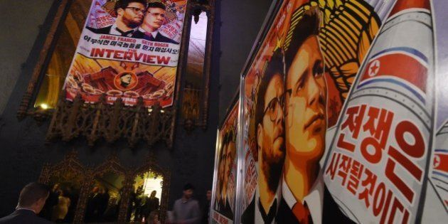 Movie posters for the premiere of the film 'The Interview' at The Theatre at Ace Hotel in Los Angeles,...