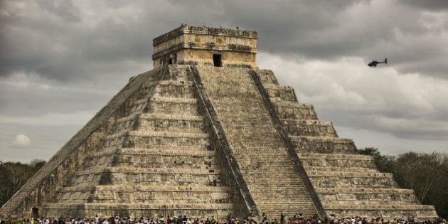 Thousands of tourists surround the Kukulcan Pyramid at the Chichen Itza archeological site during the...