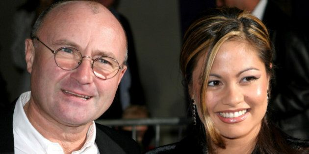 Phil Collins and wife Orianne Cevey during 'Brother Bear' - New York Premiere at New Amsterdam Theatre...
