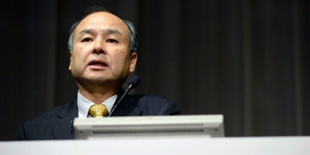 Billionaire Masayoshi Son, chairman and chief executive officer of SoftBank Corp., speaks during a news...