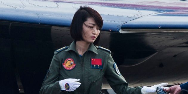 This picture taken on November 11, 2014 shows Chinese female J-10 fighter pilot Yu Xu getting ready to...