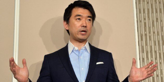 Osaka mayor and co-leader of the Japan Restoration Party Toru Hashimoto speaks before press at the Osaka...