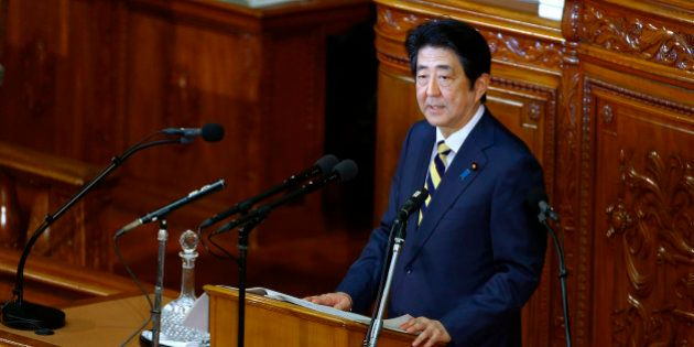 Japan's Prime Minister Shinzo Abe speaks during a regular Diet session at the lower house of Parliament...