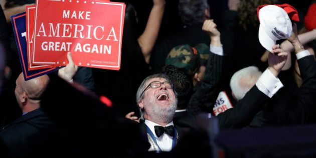 Supporters of Republican presidential candidate Donald Trump react as they watch the election results...