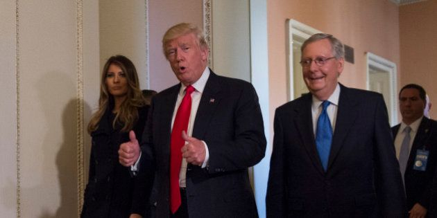 President-elect Donald Trump, flanked by his wife Melania and Senate Majority Leader Mitch McConnell...