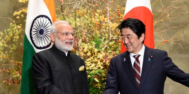 Indian Prime Minister Narendra Modi, left, is welcomed by his Japanese counterpart Shinzo Abe upon his...