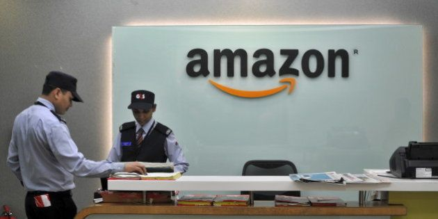 Security guards stand at the reception desk of the Amazon India office in Bengaluru, India, August 14,...