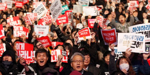 FILE - In this Saturday, Nov. 5, 2016, file photo, South Korean protesters shout slogans during a rally...