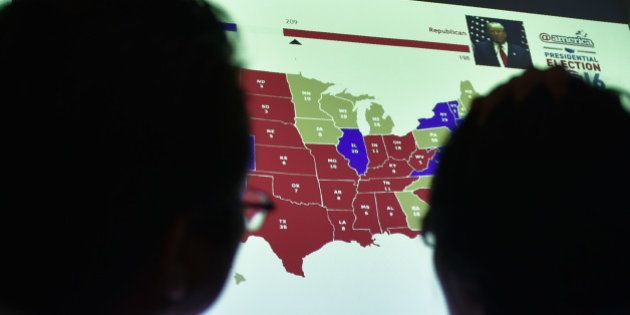 Indonesians observe a US electoral map as they wait for the results of the country's presidential election...