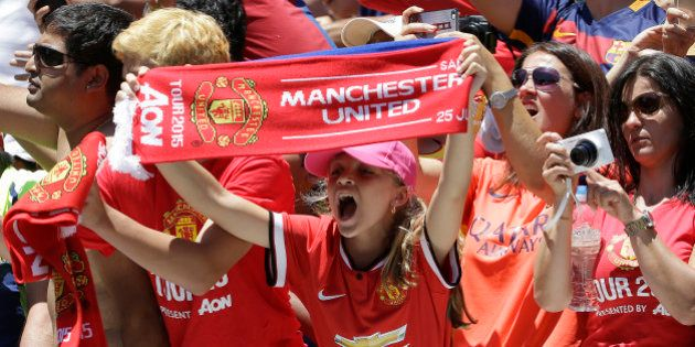 Manchester United fans cheer before an International Champions Cup soccer match between Manchester United...