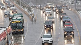 Traffic backs-up heading out of downtown on State Route 99 at the beginning of a snowstorm Friday, Feb. 8, 2019, in Seattle. Officials have issued a winter storm warning for the Puget Sound region including Seattle. The National Weather Service said the warning will be in effect from noon Friday to noon Saturday, with snow accumulations of 4 to 6 inches expected in the interior lowland areas. (AP Photo/Elaine Thompson)