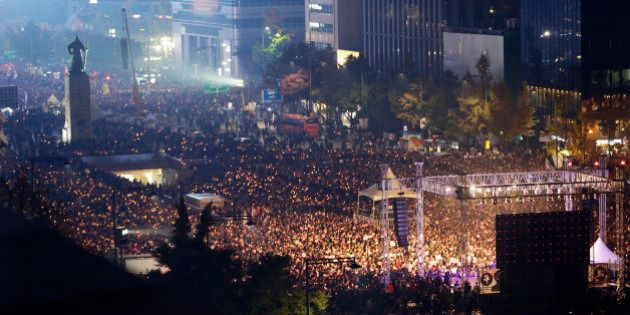 South Korean protesters stage a rally calling for South Korean President Park Geun-hye to step down in...