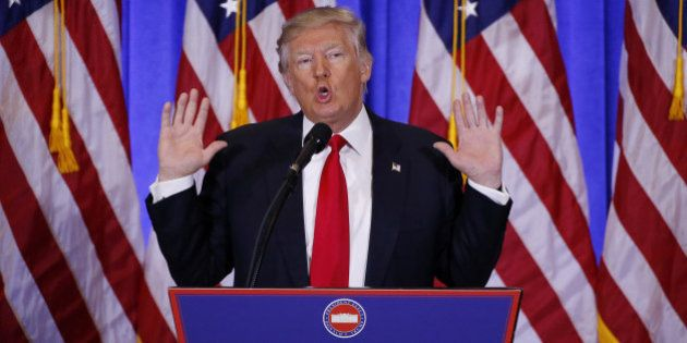 U.S. President-elect Donald Trump speaks during a news conference in the lobby of Trump Tower in Manhattan,...