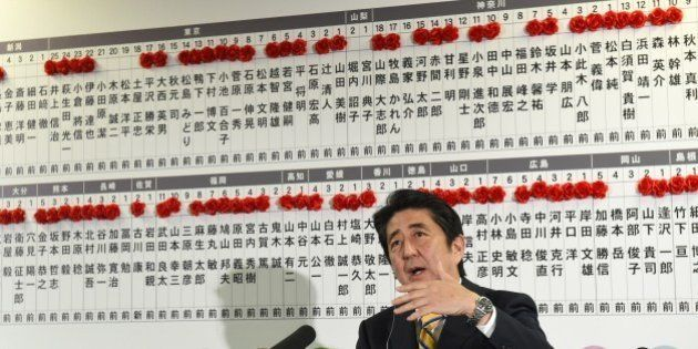 Japanese Prime Minister and ruling Liberal Democratic Party (LDP) president Shinzo Abe answers a question...