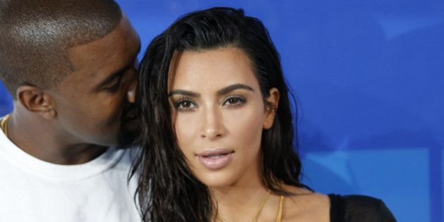 Kim Kardashian and Kanye West arrive at the 2016 MTV Video Music Awards in New York, U.S., August 28,...