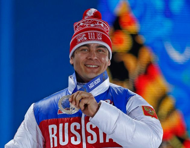 Silver medalist Albert Demchenko of Russia holds up his medal during the medal ceremony for the men's...