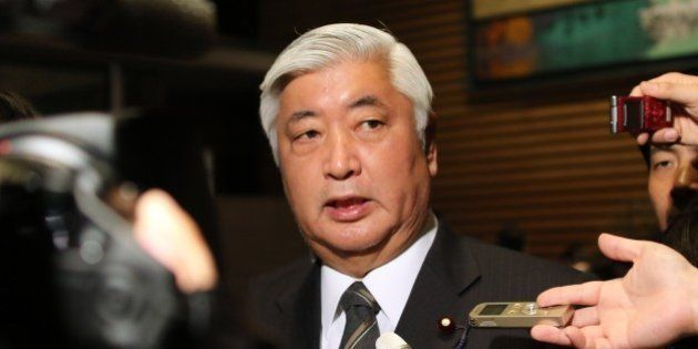 Japanese Defense Minister Gen Nakatani speakes to reporters after a cabinet meeting at the prime minister's...