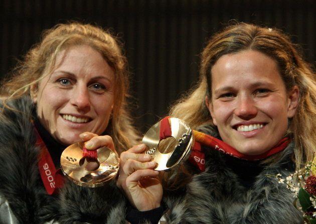 Bronze medallists Gerda Weissensteiner(R) and Jennifer Issaco of Italy celebrate after receiving their...