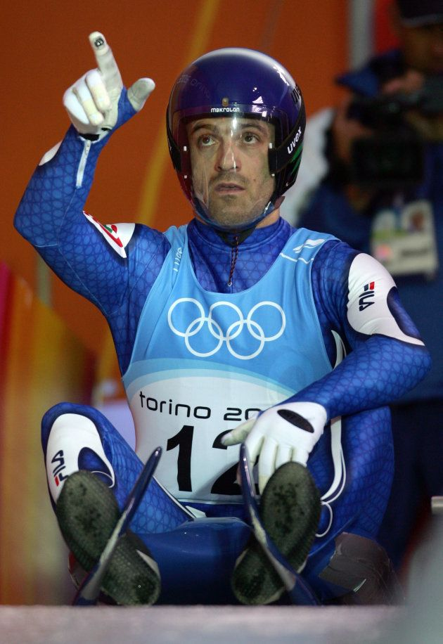 Wilfried Huber of Italy gestures during an official men luge training run for the Torino 2006 Winter...