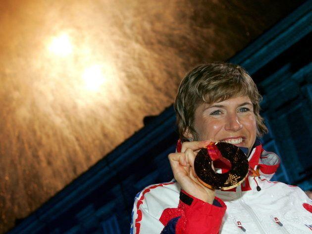 Gold medallist Katerina Neumannova of the Czech Republic celebrates after receiving her medal for winning...