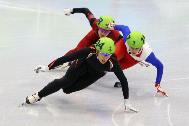 VANCOUVER, BC - FEBRUARY 13: Evgeniya Radanova of Bulgaria leads Veronique Pierron of France and Nannan...