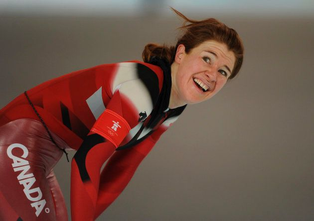 Clara Hughes of Canada smiles after skating in the women's 5,000 metres speed skating race at the Richmond...