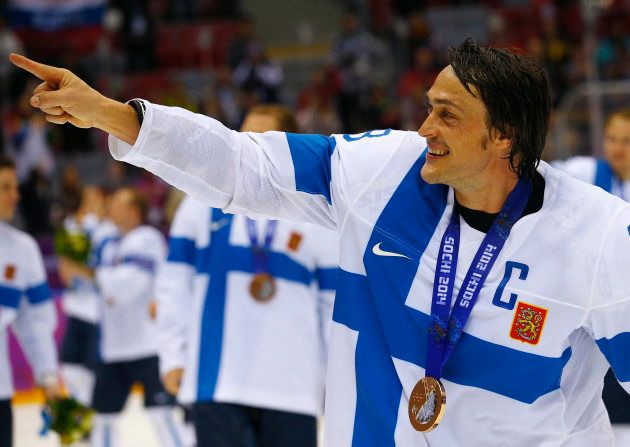 Finland's Teemu Selanne gestures as he celebrates after their men's ice hockey bronze medal victory over...