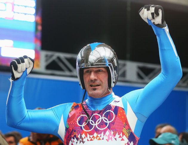 SOCHI, RUSSIA - FEBRUARY 09: Armin Zoeggeler of Italy reacts after competing during the Men's Luge Singles...