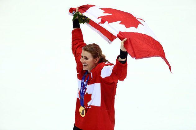 SOCHI, RUSSIA - FEBRUARY 20: Gold medalist Hayley Wickenheiser #22 of Canada celebrates during the flower...