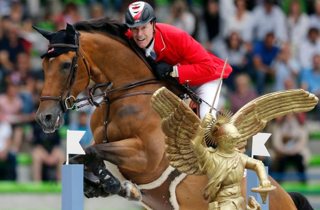Canada's Ian Millar riding Dixson competes in the jumping first competition during the World Equestrian...