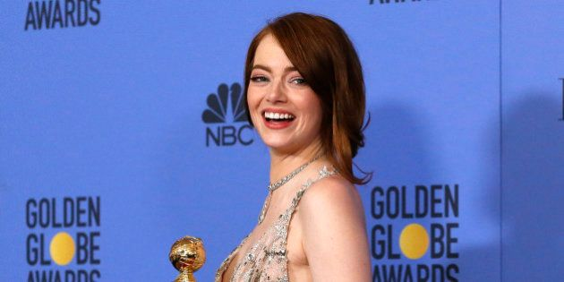 Emma Stone poses with her award for Best Performance by an Actress in a Motion Picture - Musical or Comedy...