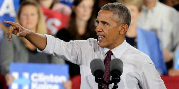 President Barack Obama speaks during a campaign rally for Democratic presidential candidate Hillary Clinton...