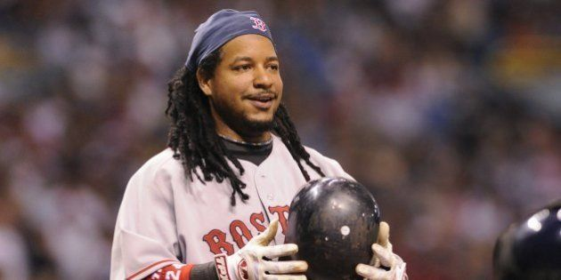 ST PETERSBURG, FL - July 2: Designated hitter Manny Ramirez #24 of the Boston Red Sox smiles after ducking...